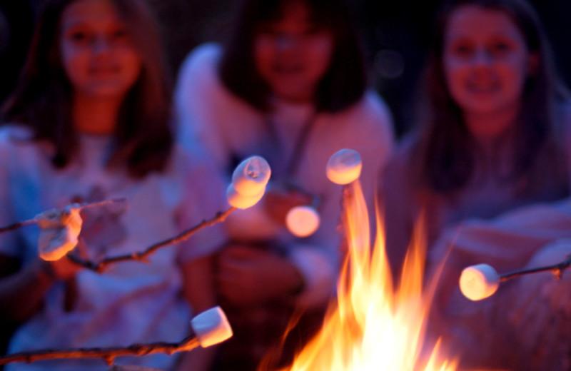 Roasting marshmallows at The Woods At Bear Creek Glamping Resort.