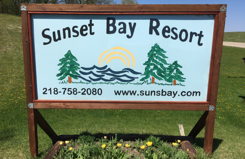 Welcome sign at Sunset Bay Resort.