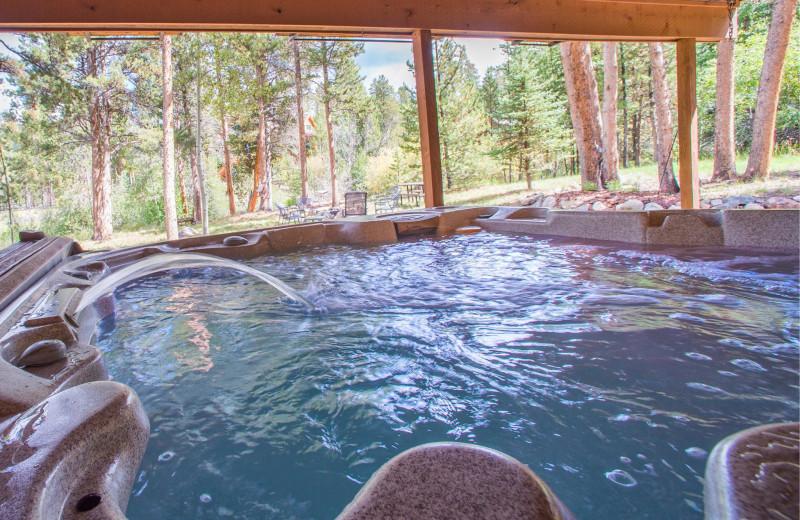 Vacation rental hot tub at Key To The Rockies Lodging Company.