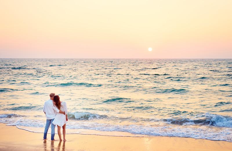 Couple on beach at Ocean Walk Hotel.