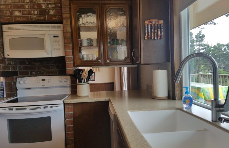 Rental kitchen at Oceanfront Getaways.