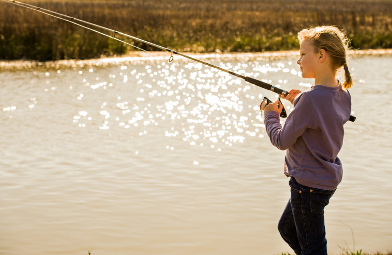 Girl fishing at the Lodge on Little St. Simons Island.
