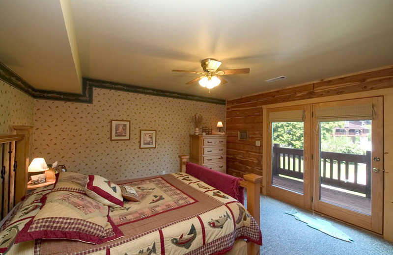 Cottage bedroom at Norfork Resort & Trout Dock.