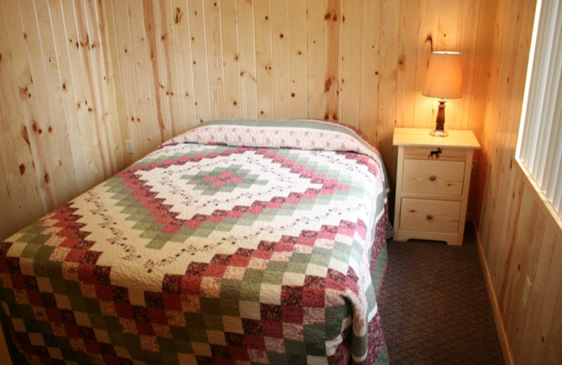 Cottage bedroom at Shady Grove Resort.