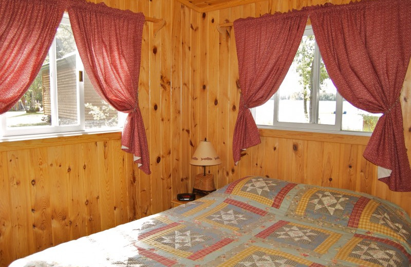 Cabin bedroom at Bear Paw Resort.