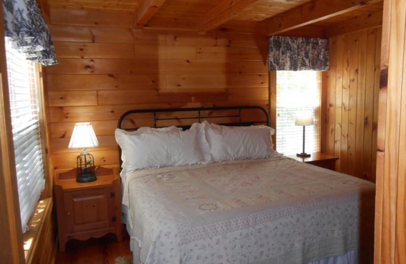Cabin bedroom at Cabins at Highland Falls.