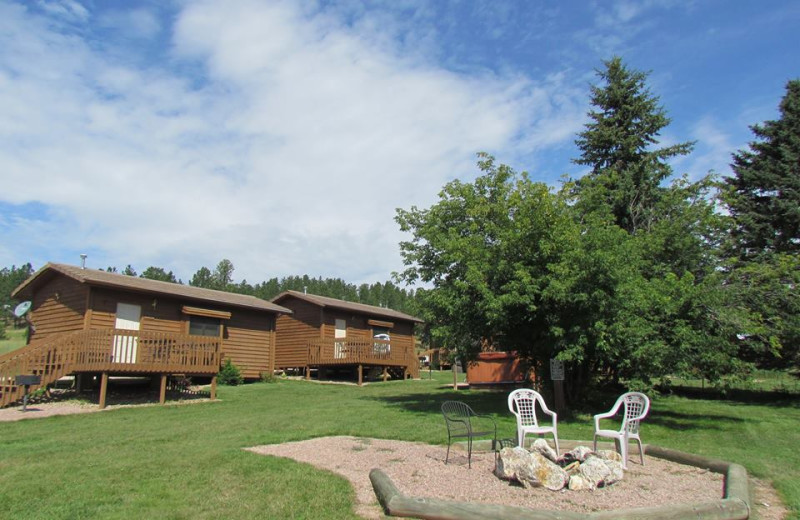 Cabins by a fire pit at High Country Guest Ranch.