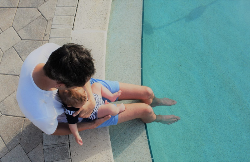 Family by pool at Cove Inn on Naples Bay.