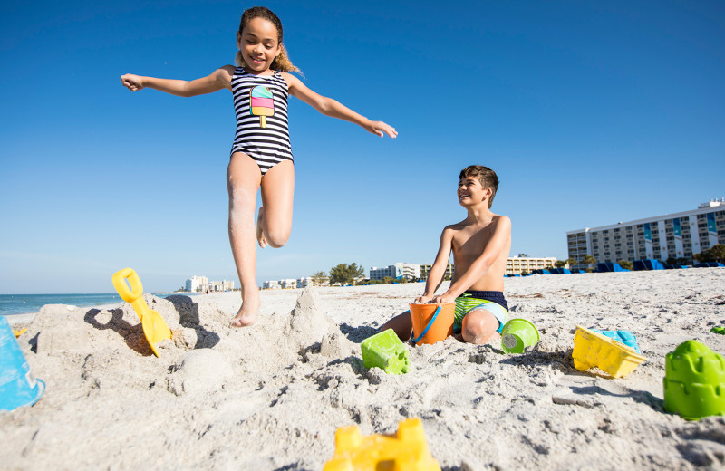 Kids on beach at TradeWinds Island Grand.