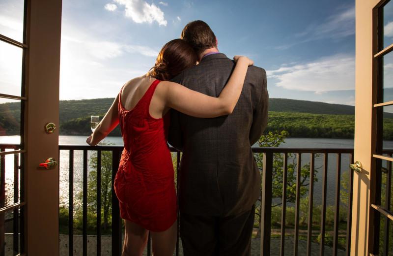 Couple on private balcony at Rocky Gap Casino Resort.
