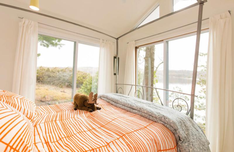 Cottage bedroom at Bobs Lake Cottages.