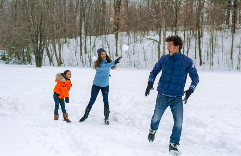 Family in snow at Fairmont Le Chateau Montebello.