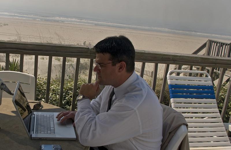 Working on the balcony at Ocean Isle Inn.