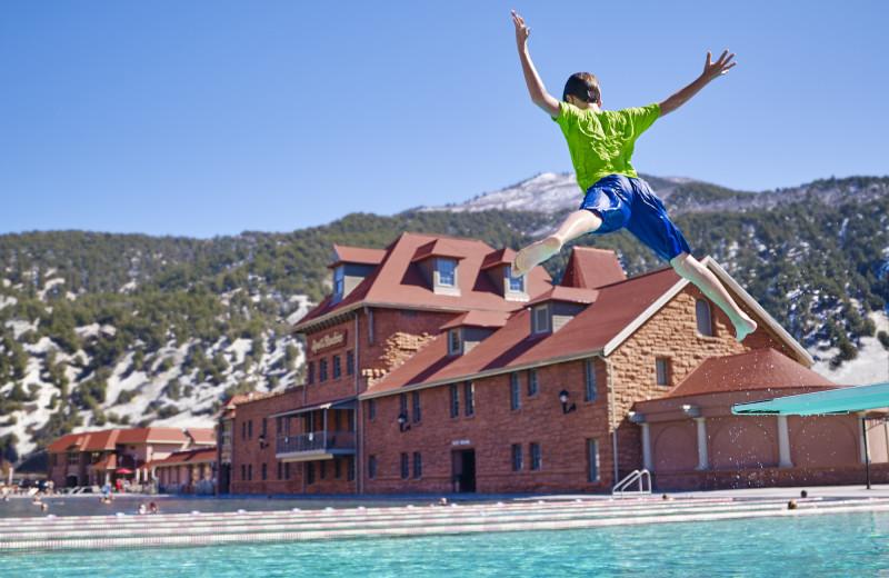Kid jumping in pool at Glenwood Hot Springs.