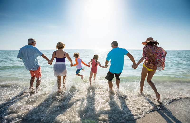 Family on beach at TradeWinds Island Grand.