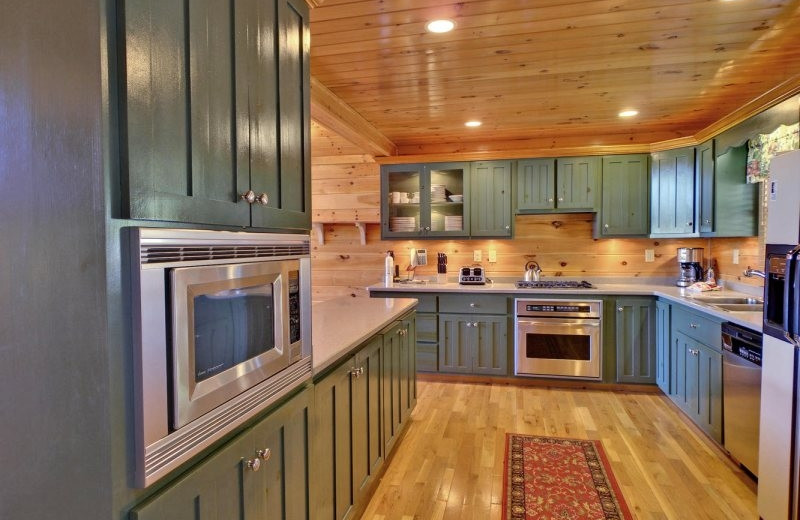Cabin kitchen at Southern Comfort Cabin Rentals.