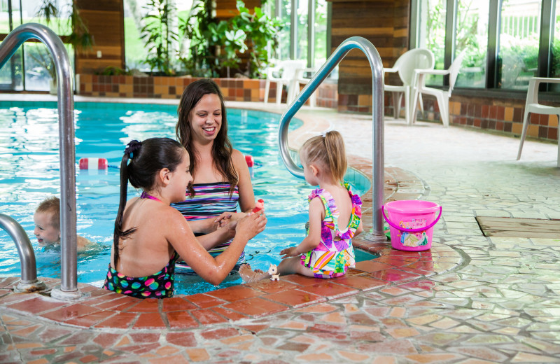 Family by indoor pool at Evergreen Resort.