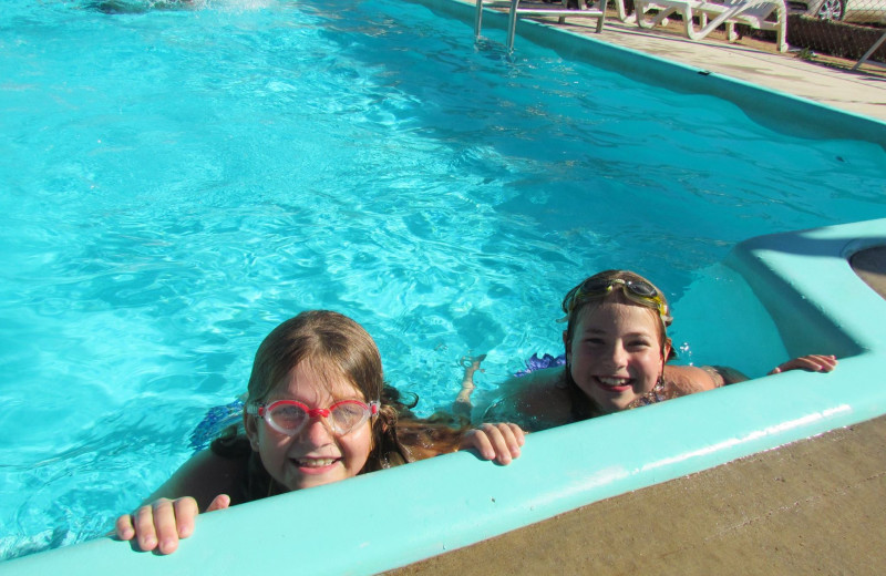Kids swimming at High Country Guest Ranch.