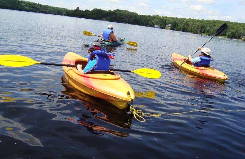 Kayaking on the Lake Sand Cottages & Inn