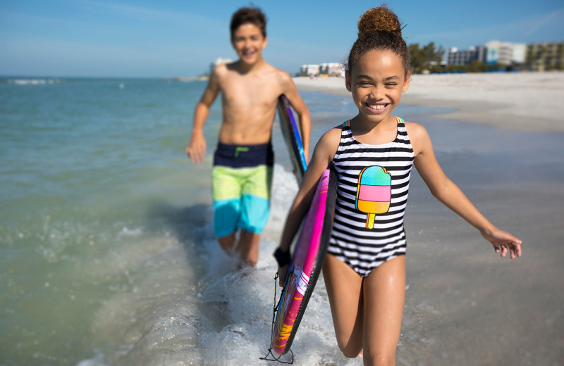 Kids on beach at TradeWinds Island Grand.