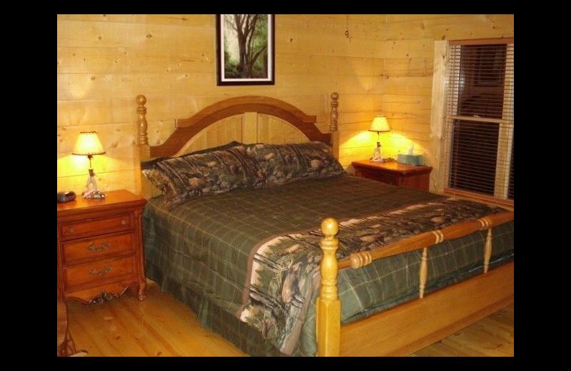 Cabin bedroom at Pine Ridge Log Cabins.