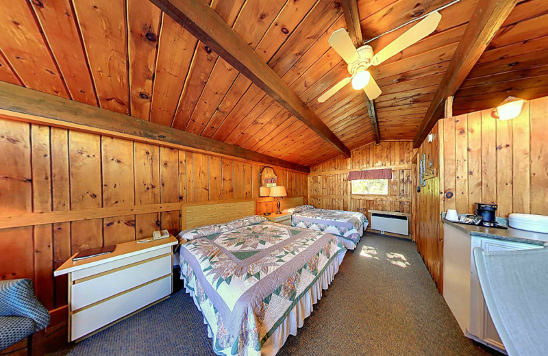 Cabin bedroom at Old Orchard Inn & Spa.