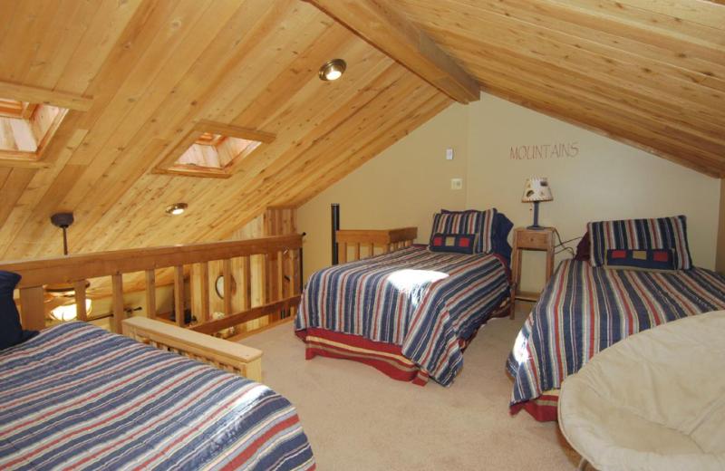 Vacation rental bedroom at Timberline Herzwoods and Northwoods Resort.