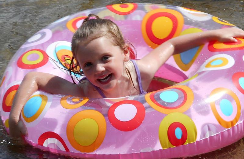 Kid swimming at Tamarac Bay Resort.