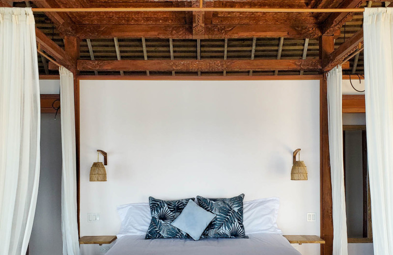 Guest bed at Bocas Bali Resort.
