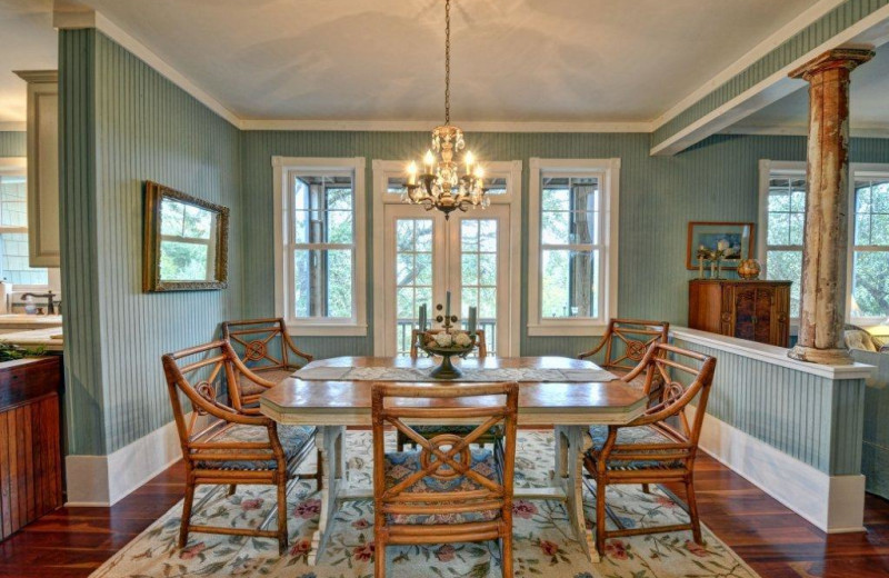Vacation rental dining room at Century 21 Action Inc.