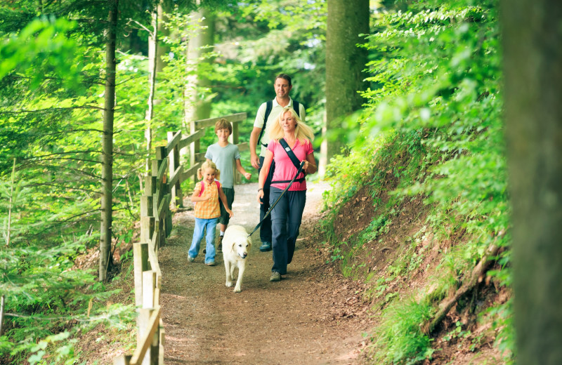 Family on a hike at Oceanfront Getaways.