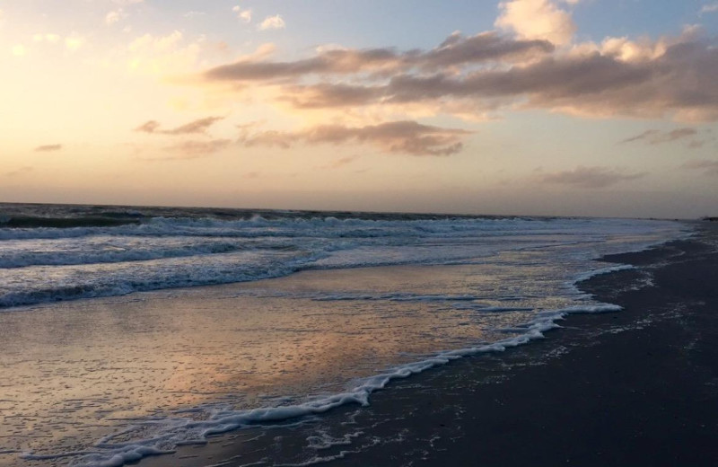 Sunset on the beach at Sunsational Beach Rentals. LLC.