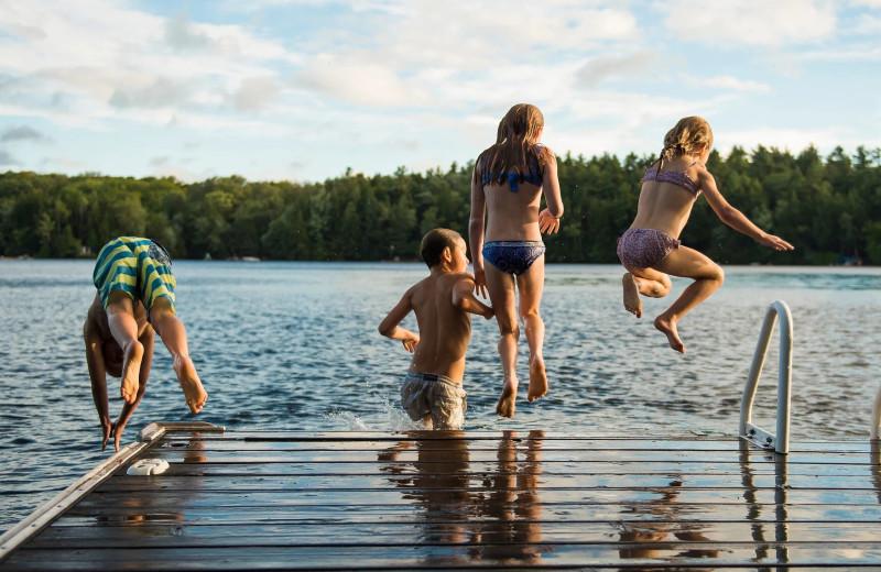 Jumping in lake at Sand Lake Resort.