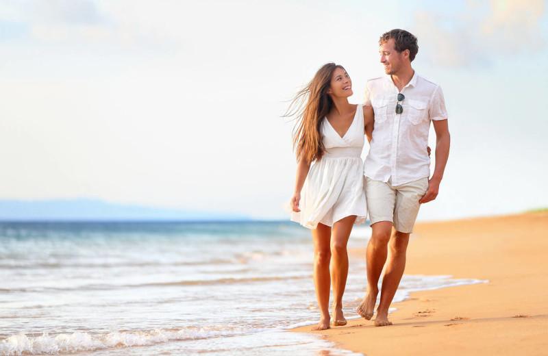 Couple on beach at Carroll Villa.