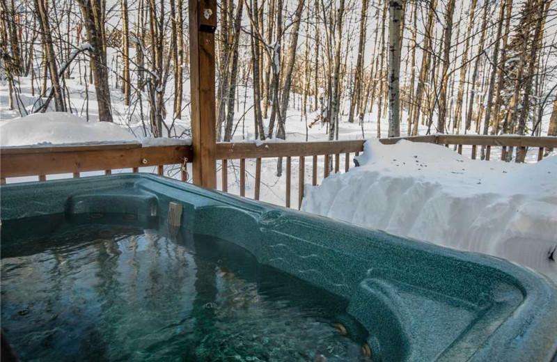 Cabin hot tub at Big Powderhorn Lodging Association.