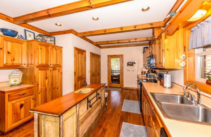 Cabin kitchen at Dogwood Cabins LLC.