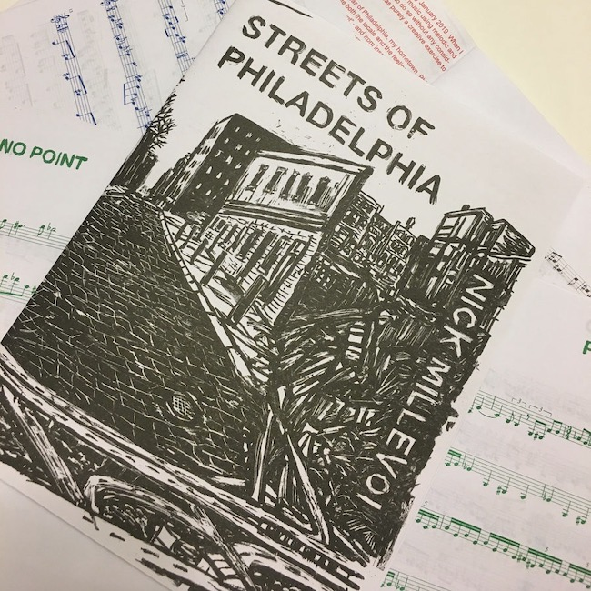 Streets of Philadelphia song book open on table