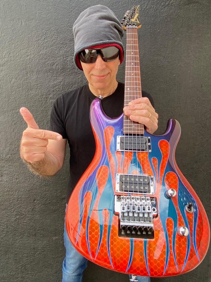 Joe Satriani with his signed Flame JS Signature