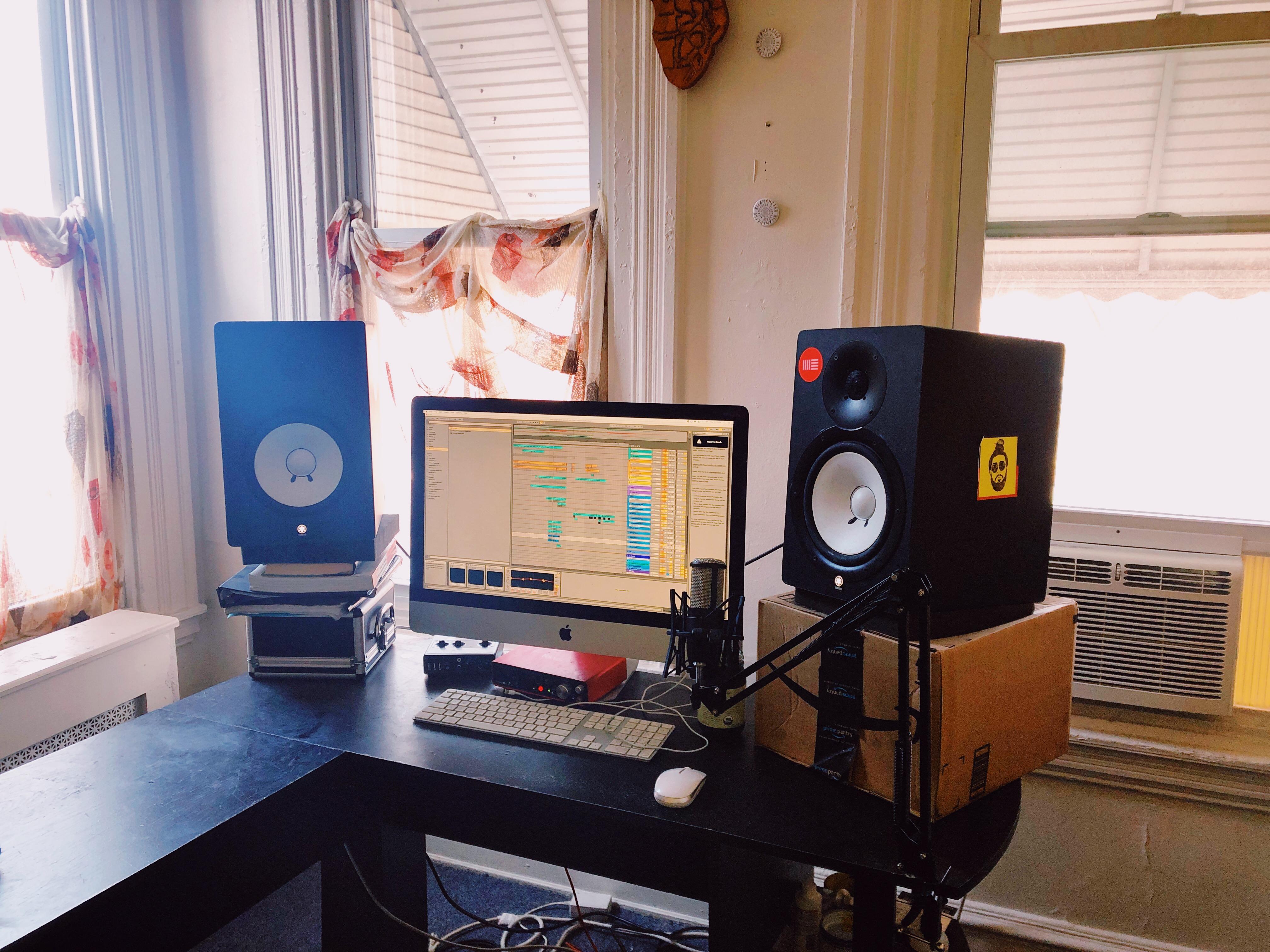 The producer's setup at home, a computer running Ableton Live and Yamaha monitors