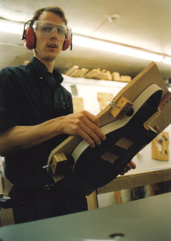 Shop manager Kraig Sagan routing body cavities.