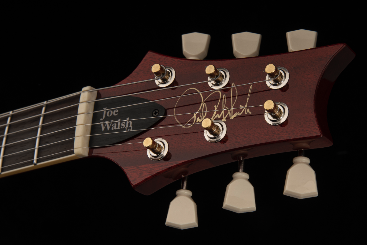 A close-up of the guitar's headstock.