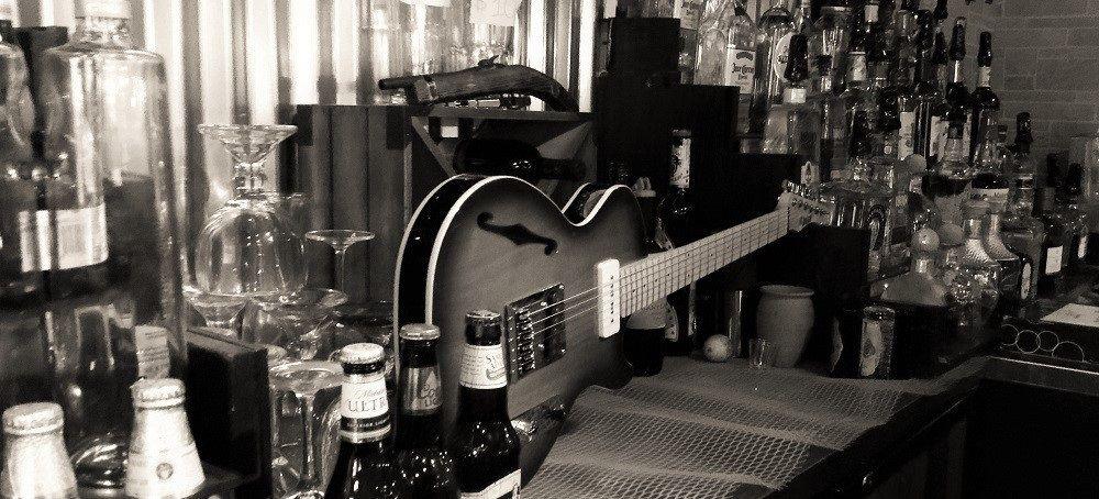 artists friends bootlegger guitar. Black Bedroom Furniture Sets. Home Design Ideas