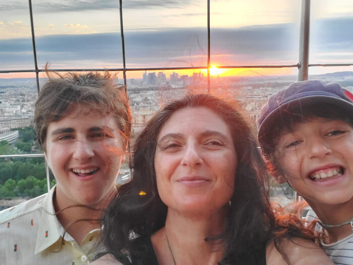 Sarah and her family enjoying a sunset from the Eiffel Tower in Paris, France.