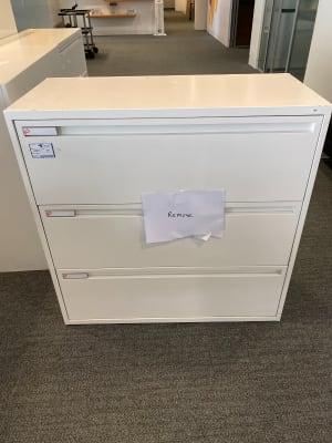 White metal filing cabinet three drawers