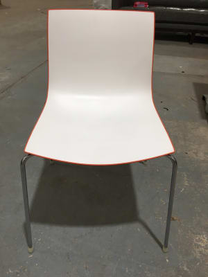 Arper waiting room chair with orange trim