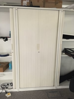 Tall tambour cabinet