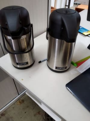 two black-and-grey hot drink dispensers