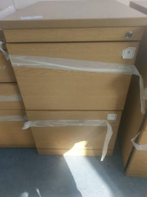 brown wooden file cabinet