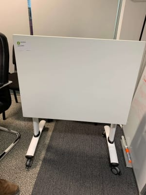 Small folding white table on wheels
