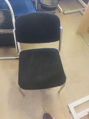 gray metal framed black fabric padded chair